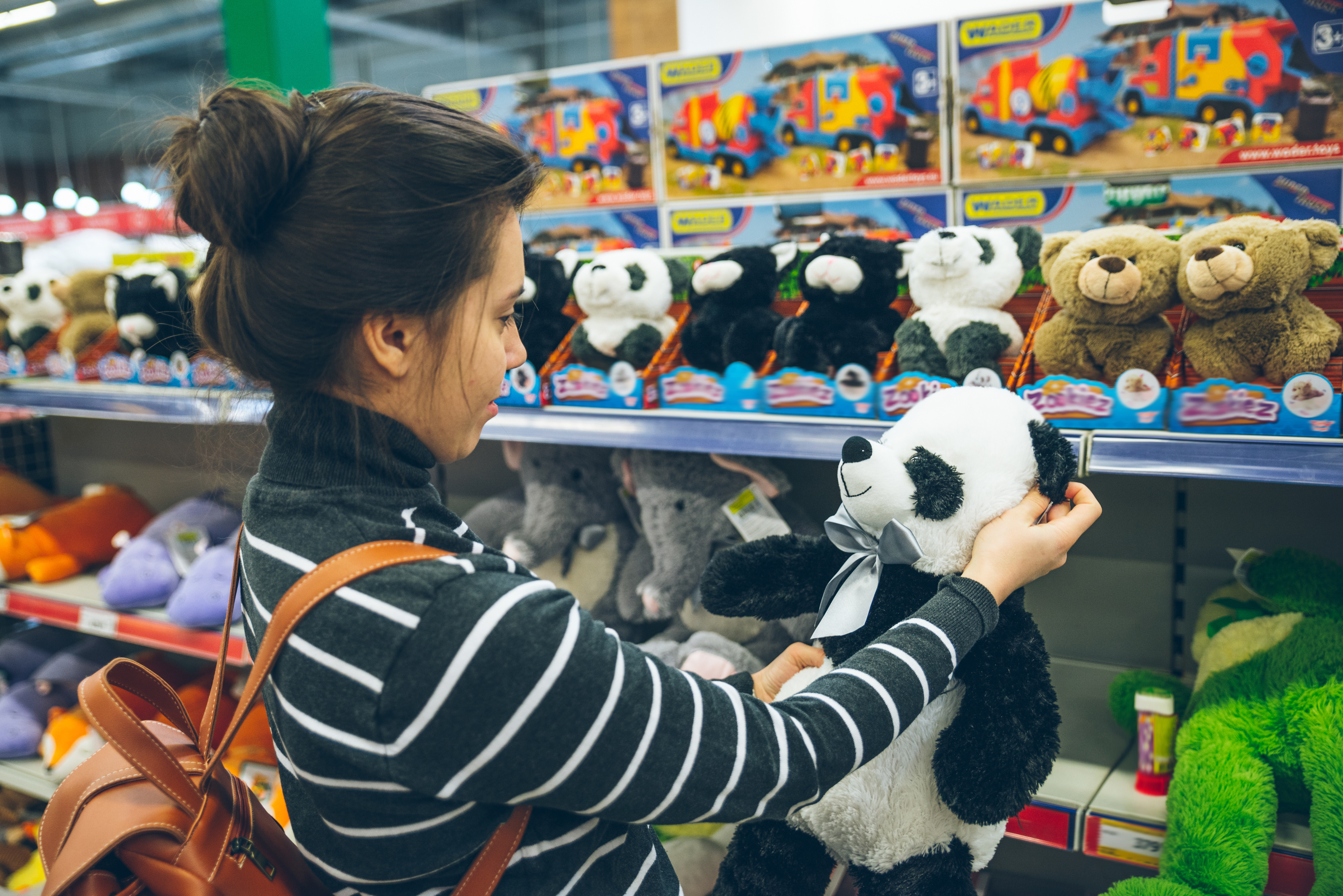 woman look for soft panda toy