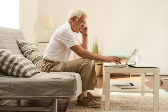 Senior Man Working in Living Room